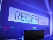 edge lit signs: reception sign edge lit via blue leds