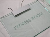 Edge Lit ( non illuminated sign example ) in glass by Megaled for 5 star hotel development gym signage, in Surrey, UK.